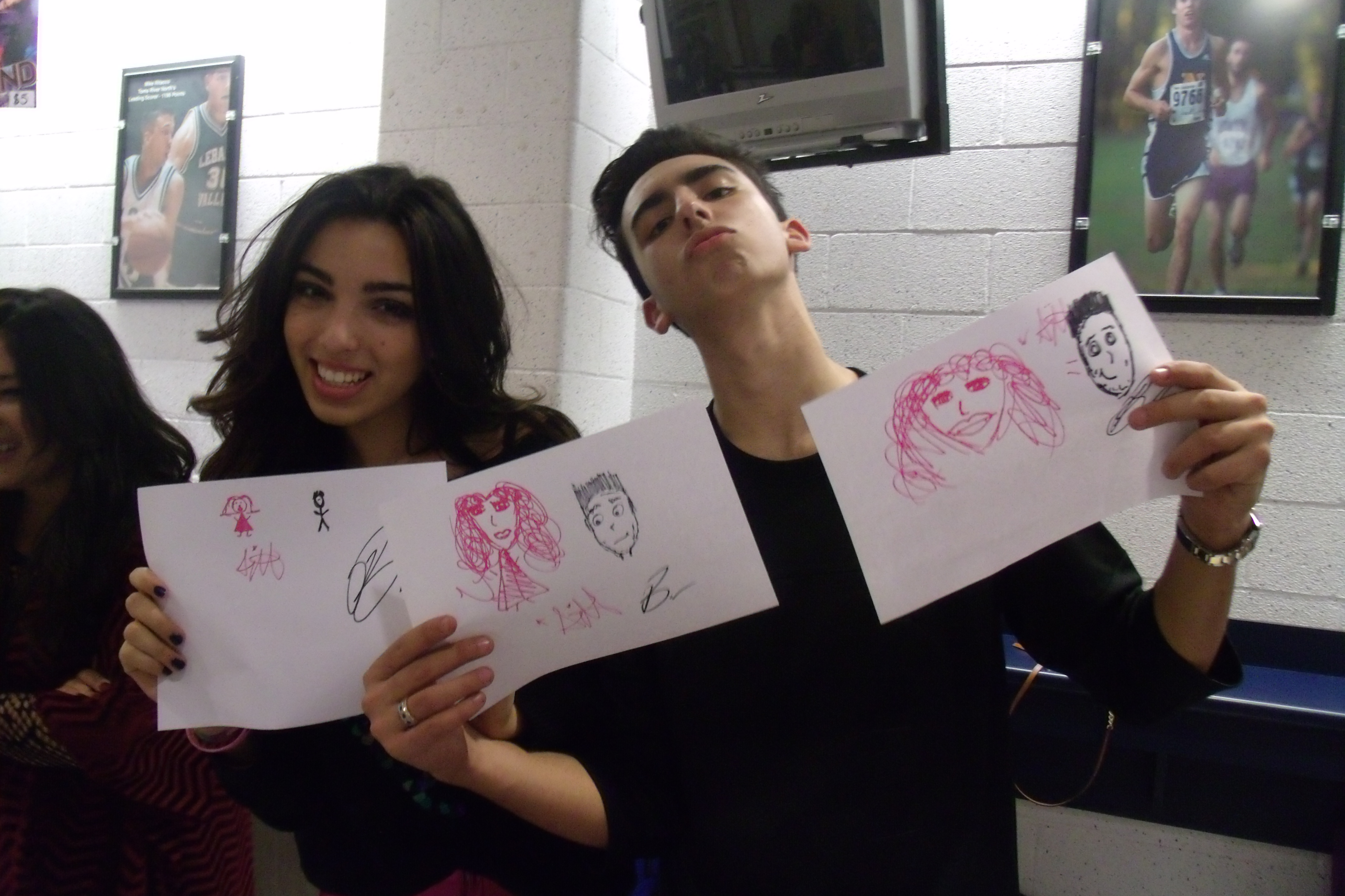 Brandon & Savannah with their drawings of themselves!