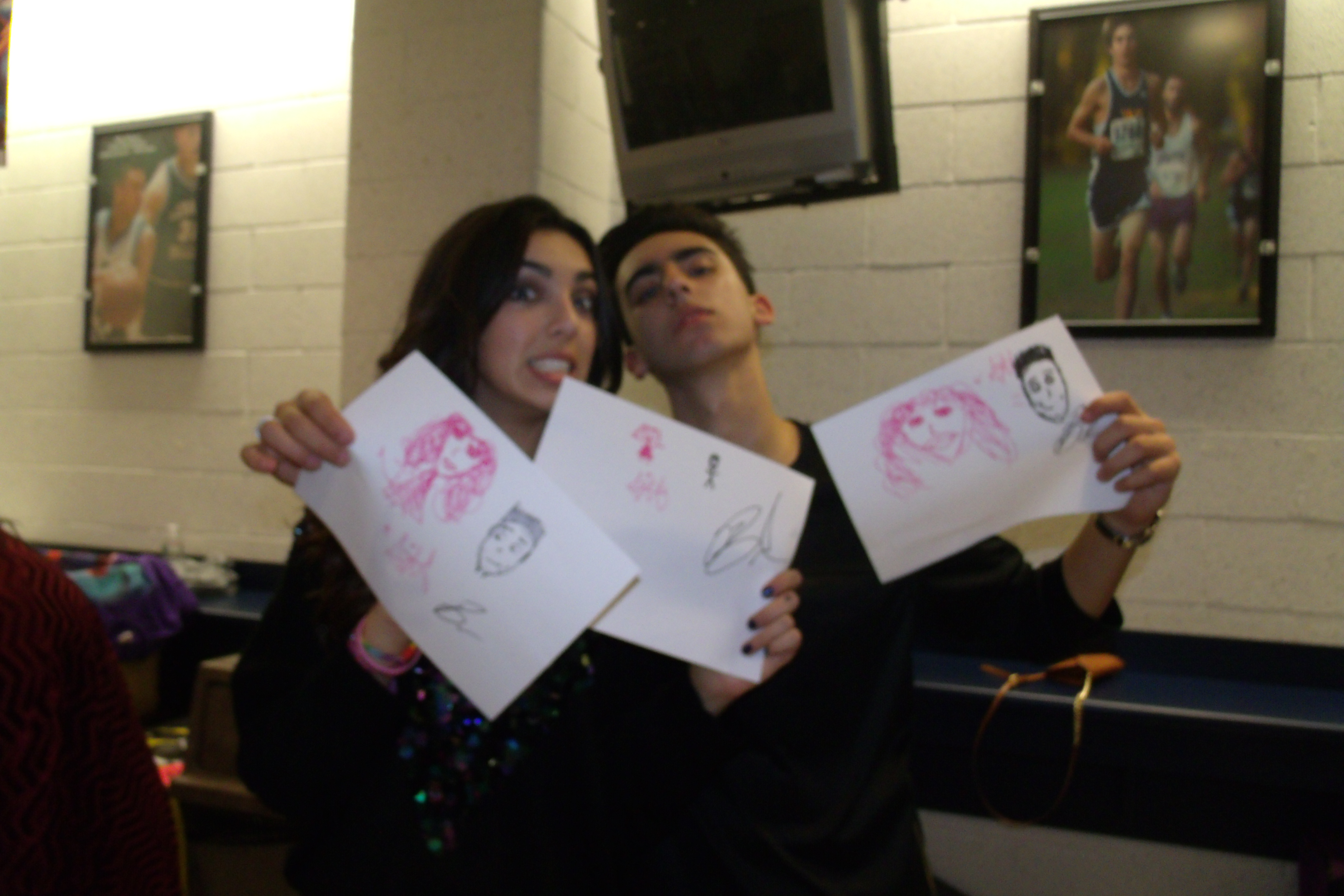 Brandon & Savannah goofing off with their drawings of themselves!