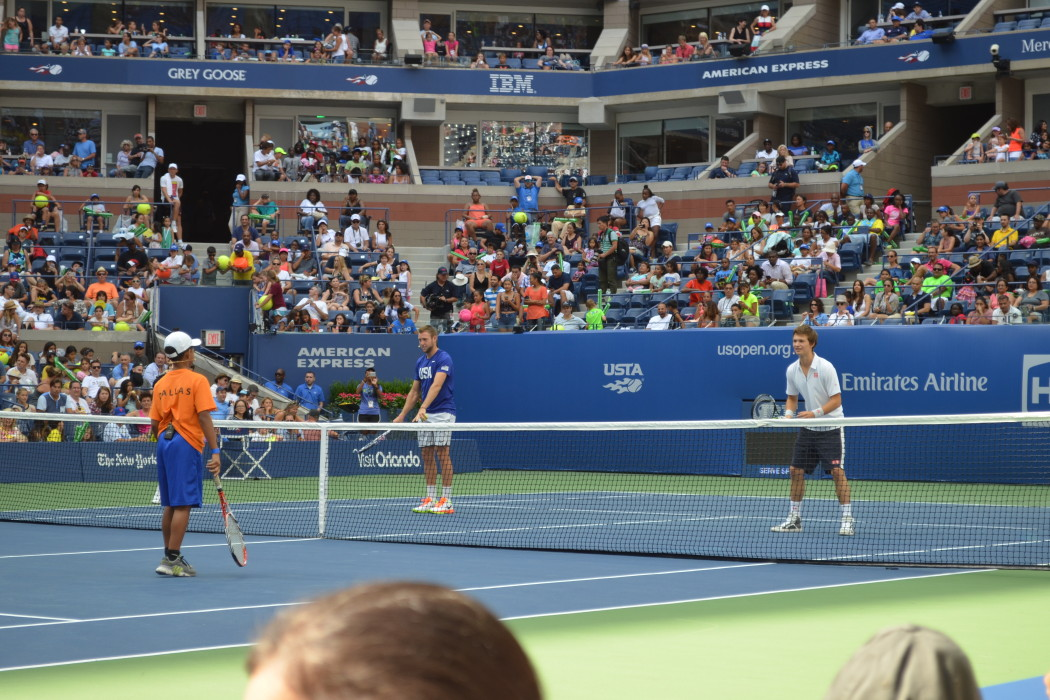 Ansel Elgort and tennis pro Jack Sock play skill games with youth players at Arthur Ashe Kids' Day 2016  Photo Credit: Kimberly Strong